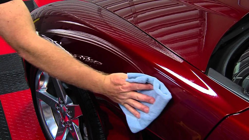 Quick detailer being wiped off