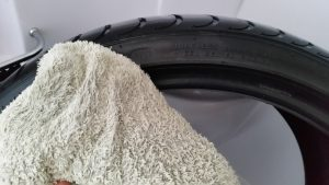 A clean white towel after wiping the tyre shows how clean it is